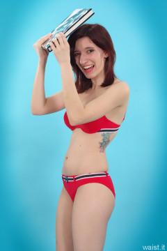 Dawsie doing deportment exercises in red bikini