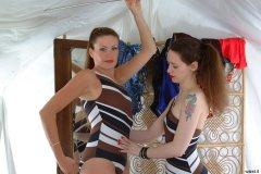 Chiara corrects Alison's posture. Alison and Chiara
