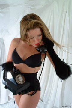 Alison modelling Maidenform waist-nipper girdle and opera gloves
