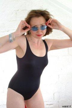 Debbie in black one-piece swimsuit
