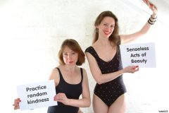 Debbie and Chiara in black one-piece swimsuits