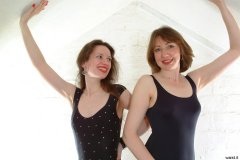 Chiara and Debbie in black one-piece swimsuits