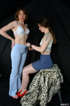 Chiara laces up Debies tight-fitting trousers