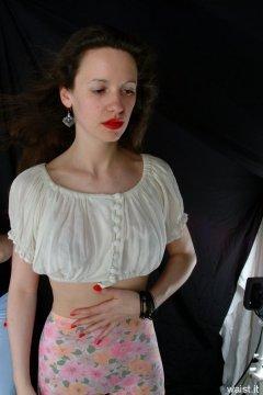 Chiara in white crop top and flowery 1960's medium-leg M&S pantie girdle, worn as hot pants