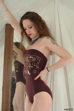 Chiara in maroon one-piece swimsuit