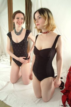 Chiara and Annie modelling black one-piece swimsuits