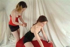 Annie laces Chiara into her velvet Italian corsey