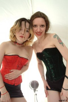 Annie and Chiara pose in their tightly-laced corsets