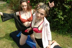 Chiara and Annie in pink bras and black girdles