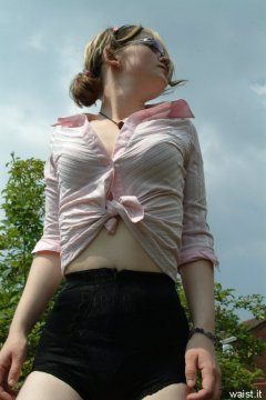 Annie modelling pink blouse tied at the waist  + zip-front panty-girdle