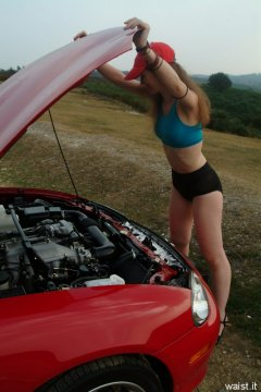 Chiara in blue top and black Dim-Up pantie girdle worn a hot pants