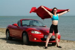 Chiara at Tanners Lane Beach with red Mazda MX5