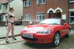 Chiara 'bikini carwashes' a red MX5