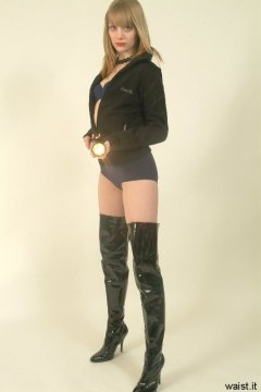 Carlie wears blue girdle as hot pants, teamed up with jacket and patent thigh boots