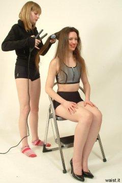 Carlie straightens Chiara's hair