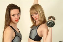 Chiara and Carlie pose in matching sportswear tops and hot pants