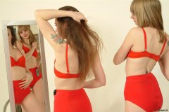 Carlie and Chiara try on their matching red padded bras and special figure-shaping 'pocket' girdles.