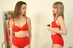 Chiara and Carlie try matching red padded bras and special figure-shaping 'pocket'girdles.