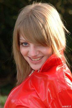 Carlie models red PVC jacket