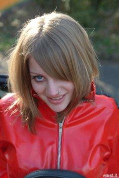 Carlie models red PVC jacket.