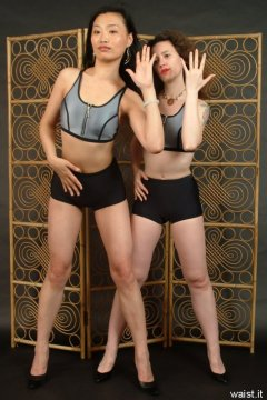 Moonlit Jane and Chiara in silver neoprene tops and tight lycra shorts