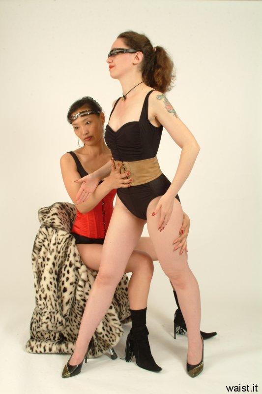 Moonlit Jane tightens leather corset-belt on Chiara