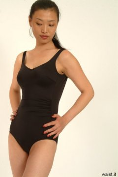 Moonlit Jane tries on a fifties-style, tight, black, lycra, tummy-control one-piece swimsuit