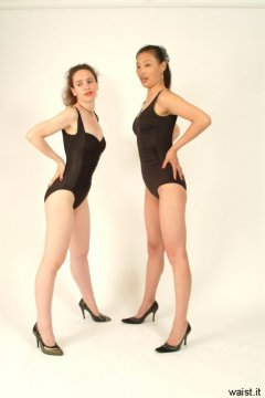 Chiara and Moonlit Jane model fifties-style, tight, black, lycra, tummy-control one-piece swimsuits.