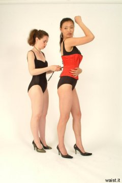 Chiara laces Moonlit Jane into tight Vollers corset.