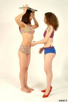 """""""Pull your navel in towards your spine..."""" Chiara prods Moonllt Jane's tummy to remind her to tuck it in"""