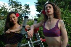Moonlit Jane and Chiara pose in bikinis in the garden