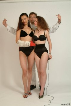 Chiara and Moonlit Jane in bras and tight Maidenform waist-nipper girdles