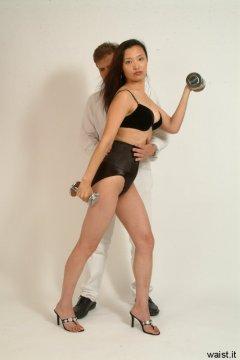 Chest up, tummy in - posing Moonlit Jane in bra and tight Maidenform waist-nipper girdle (taken by Chiara)