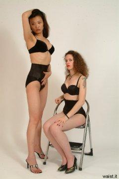Moonlit Jane and Chiara, both wearing bras and tight Maidenform waist-nipper girdles