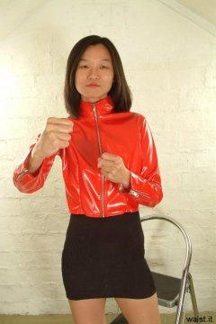 Vicki modelling red PVC jacket and tight-fitting shapewear worn as mini-skirt