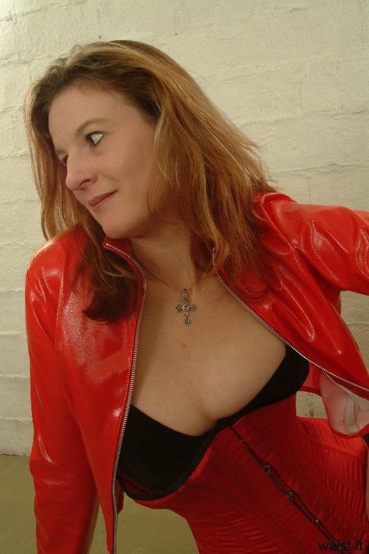 Juleigh in PVC jacket, tightly laced into Vollers corset