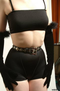 Chiara black lycra top and bottoms and belt tied tightly at the waist