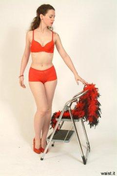 Chiara models red bra and boy-short lace panties