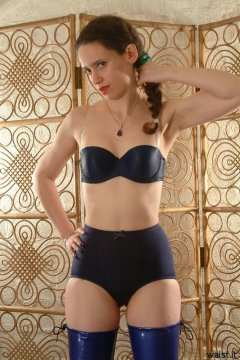 Chiara in blue bra and matching vintage style pantie girdle, and PVC beddyboots