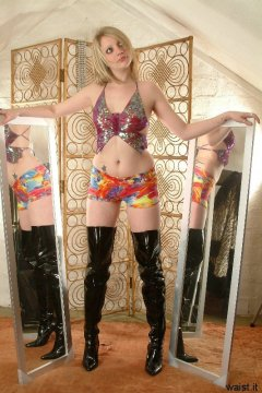 Carlie iin butterfly dance to lycra hipster hotpants and patent leather thigh boots
