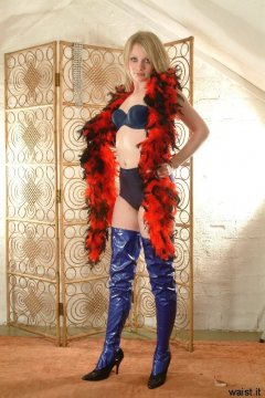 Carlie in blue bra and matching vintage style pantie girdle, and PVC beddyboots
