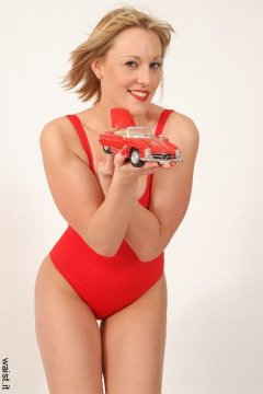 """2005-05-13 Nikki in tight red """"Baywatch"""" style one-piece swimsuit"""