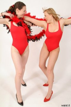 """2005-05-13 Chiara and Nikki in tight red """"Baywatch"""" style one-piece swimsuits"""