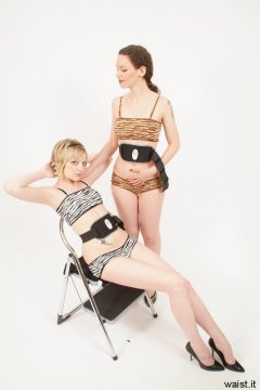 """Carlie and Chiara with Absonic """"buzzybelts"""" on their tummies to wake up her tummy muscles"""