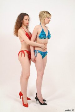 PULL THAT TUMMY IN! Chiara and Carlie in bikini-style dance costumes