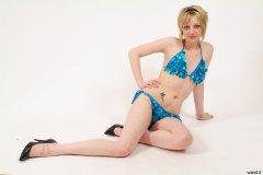 Carlie in blue bikini-style dance costume