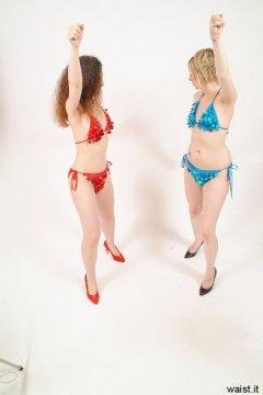 Chiara and Carlie in bikini-style dance costumes