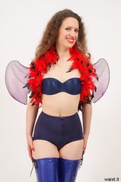 Chiara in matching blue bra and vintage style pantie girdle, with feather boa