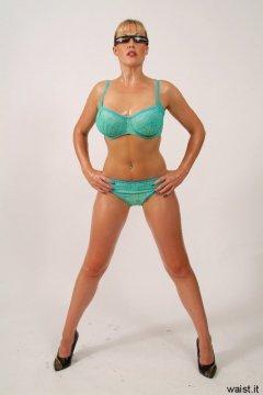 Baby-oiled Nikki poses in her turquoise bikini