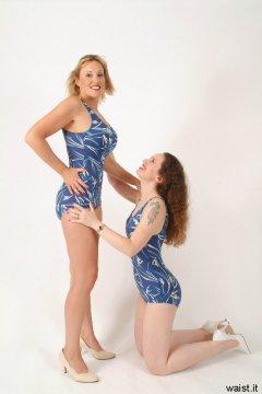 Chiara adjusts Nikki's posture